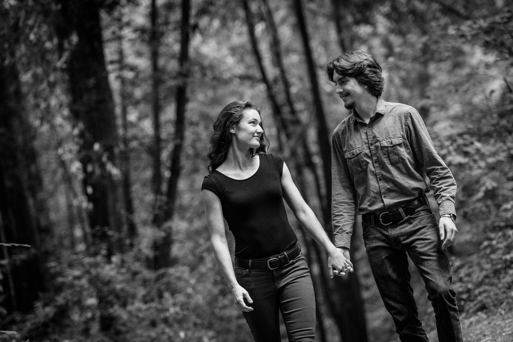 Couple in forest walking towards camera B&W - Engagement Photos in Nisene Marks Forest in Aptos, CA - by Bay Area wedding photographer Chris Schmauch
