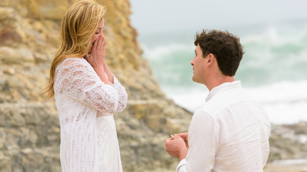 Wedding proposal at Davenport Beach in Davenport, California