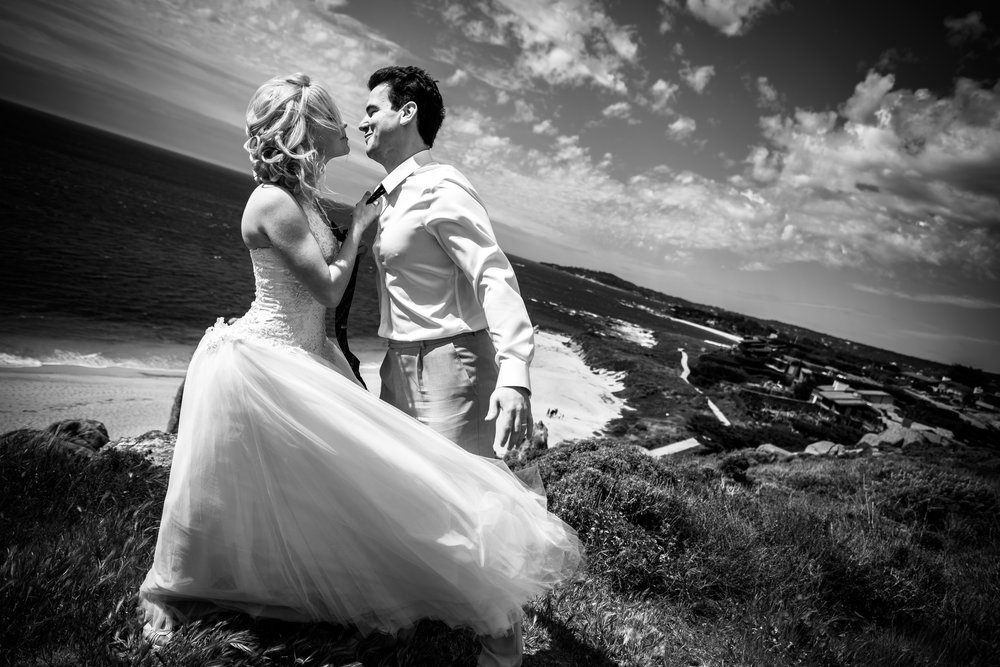 Bride and groom on a windy day after eloping at Cathedral Rock in Carmel, California