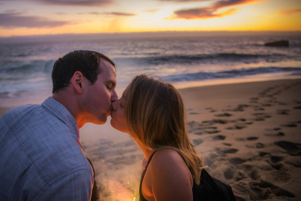 When sparks fly... 5 year wedding anniversary couples session at Panther Beach, Santa Cruz - Photo by Bay Area wedding photographer Chris Schmauch