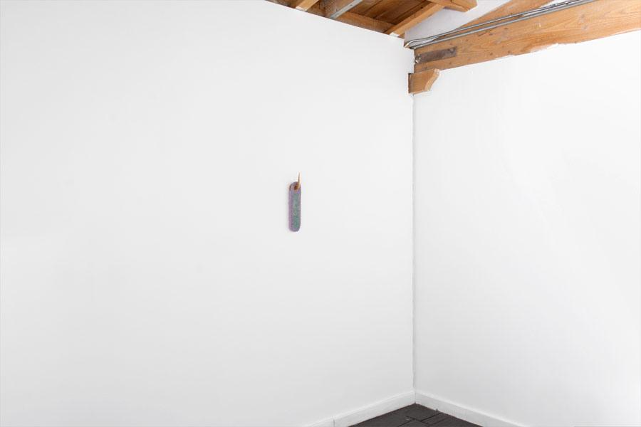 "TS I KK U N D, Fiberglass reinforced plaster, pigment, carved basswood, 14"" x 4"" x 3"", 2015 (image courtesy artist website)"