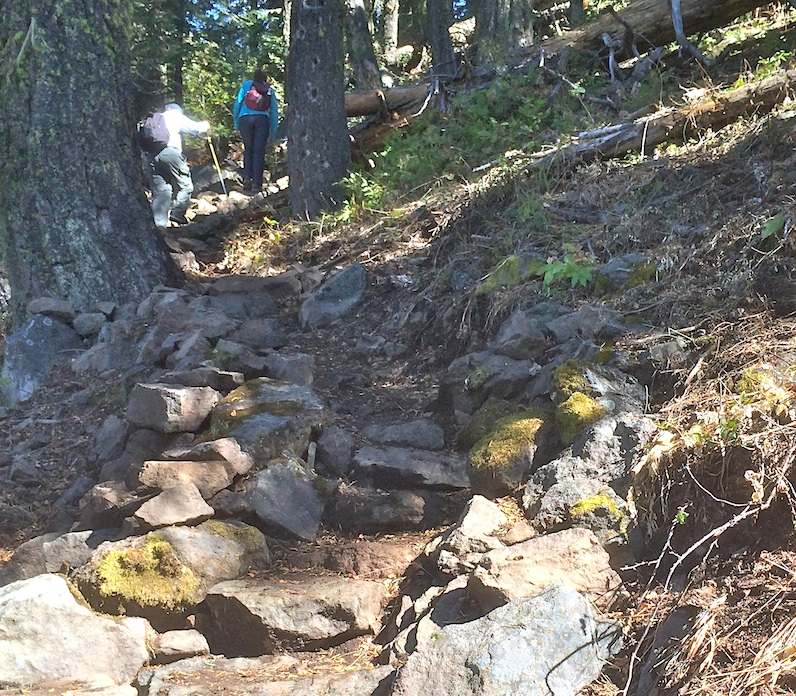 Hikers walk up Stone steps on Pilot Rock Trail. WWC 2014 Photo