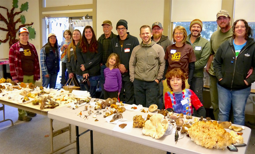 Citizen Scientists  with Their array of mushrooms, found During  BioBlitz 2016.    T Dickey 2016 photo
