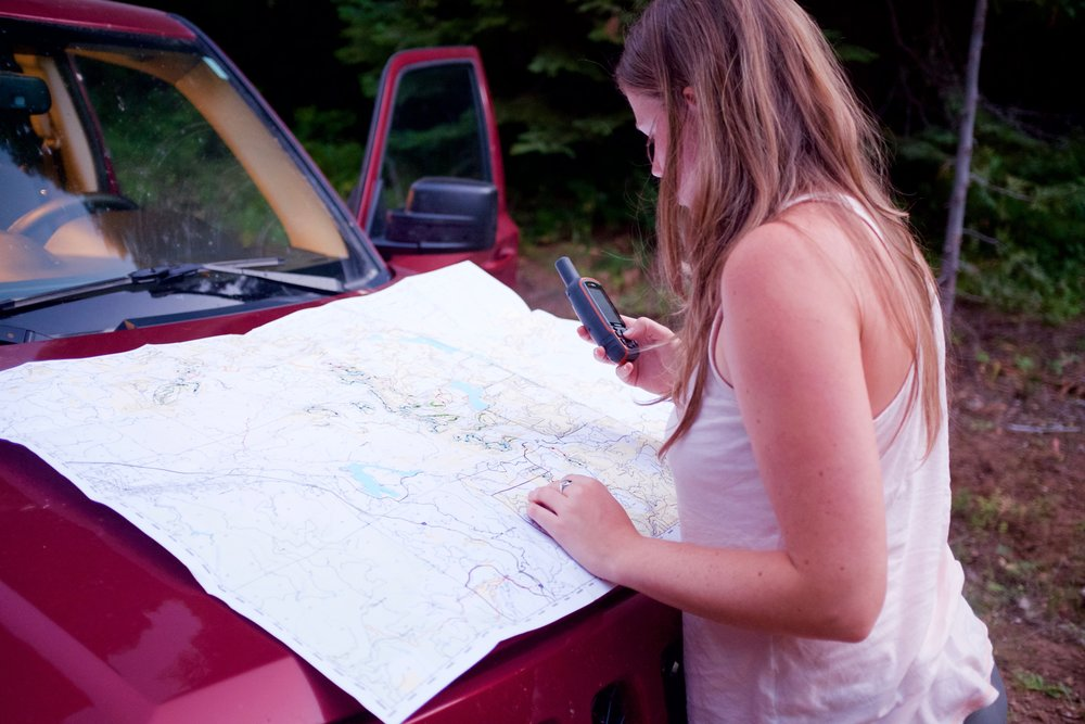 Emily Burke uses a BLM map and a GPS to navigate to the night's first owl calling station on Soda Mountain Road near Hobart Bluff.