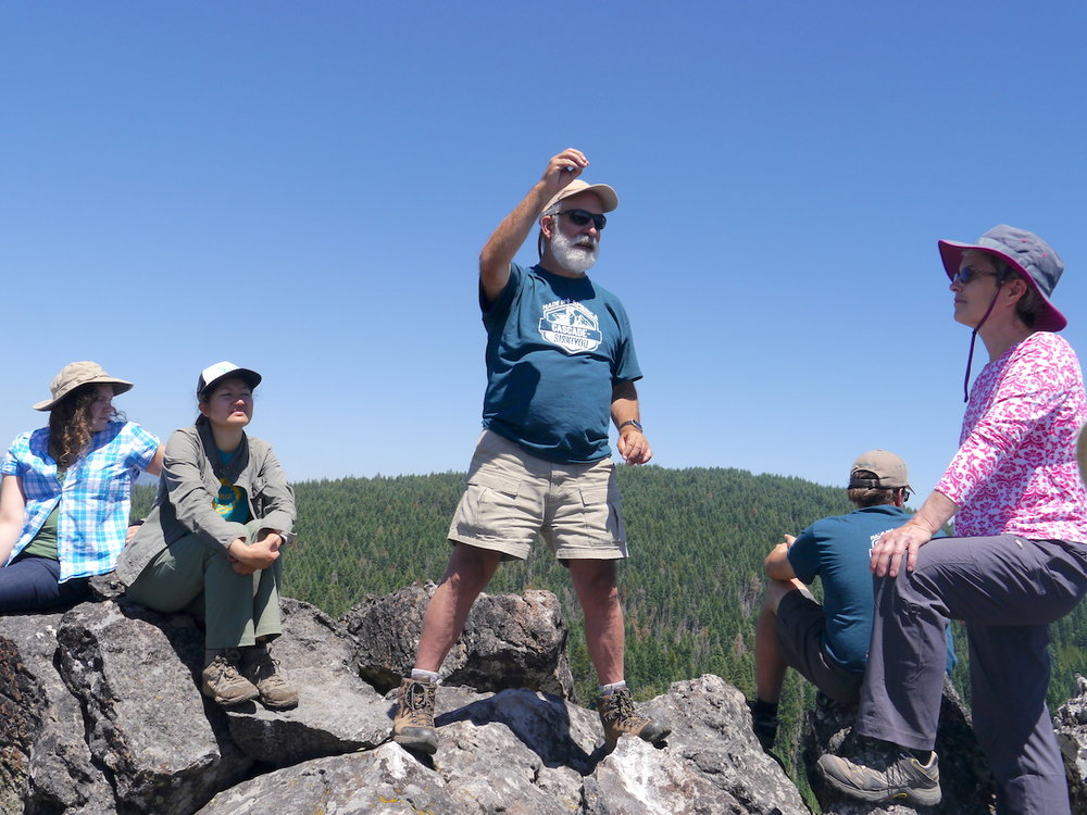 At Vulture Rock: Dr. Michael Parker, tells about the biodiversity in Cascade-Siskiyou National Monument.  2017 TPD photo.