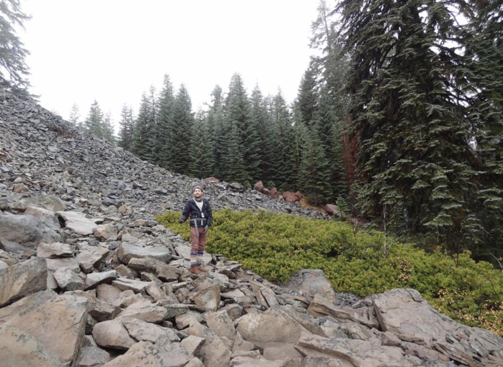 Neil Clayton, researching American pika, taking data along Surveyor Ridge.