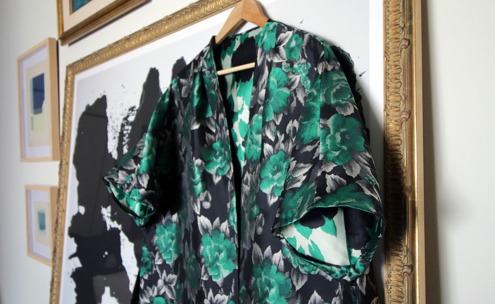 The Kimono-Sleeve Opera Jacket hangs over a framed print of   Rorschach   by  Andy Warhol,  works by   Claire Oswalt   pictured left.