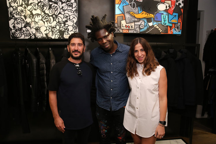 Eran Elfassy and Elisa Dahan with Bradley Theodore in the Soho, New York.