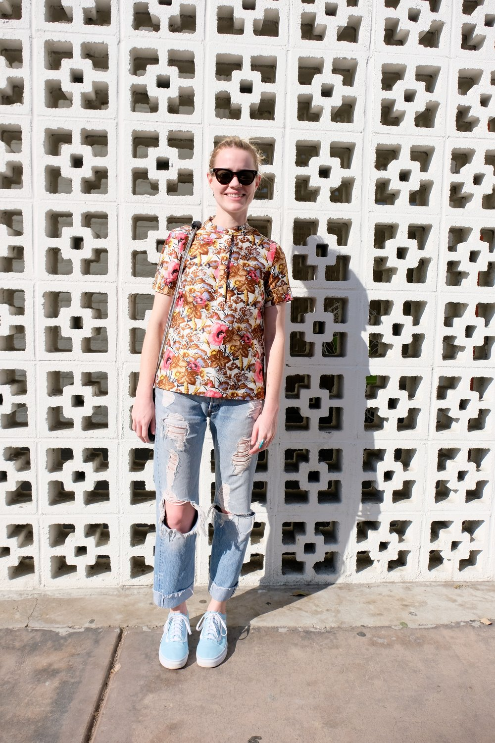 Celine  wayfarer sunglasses,  J.Crew Collection  top,  Re/Done  vintage Levi's and  Vans Old School  sneakers in ice blue.