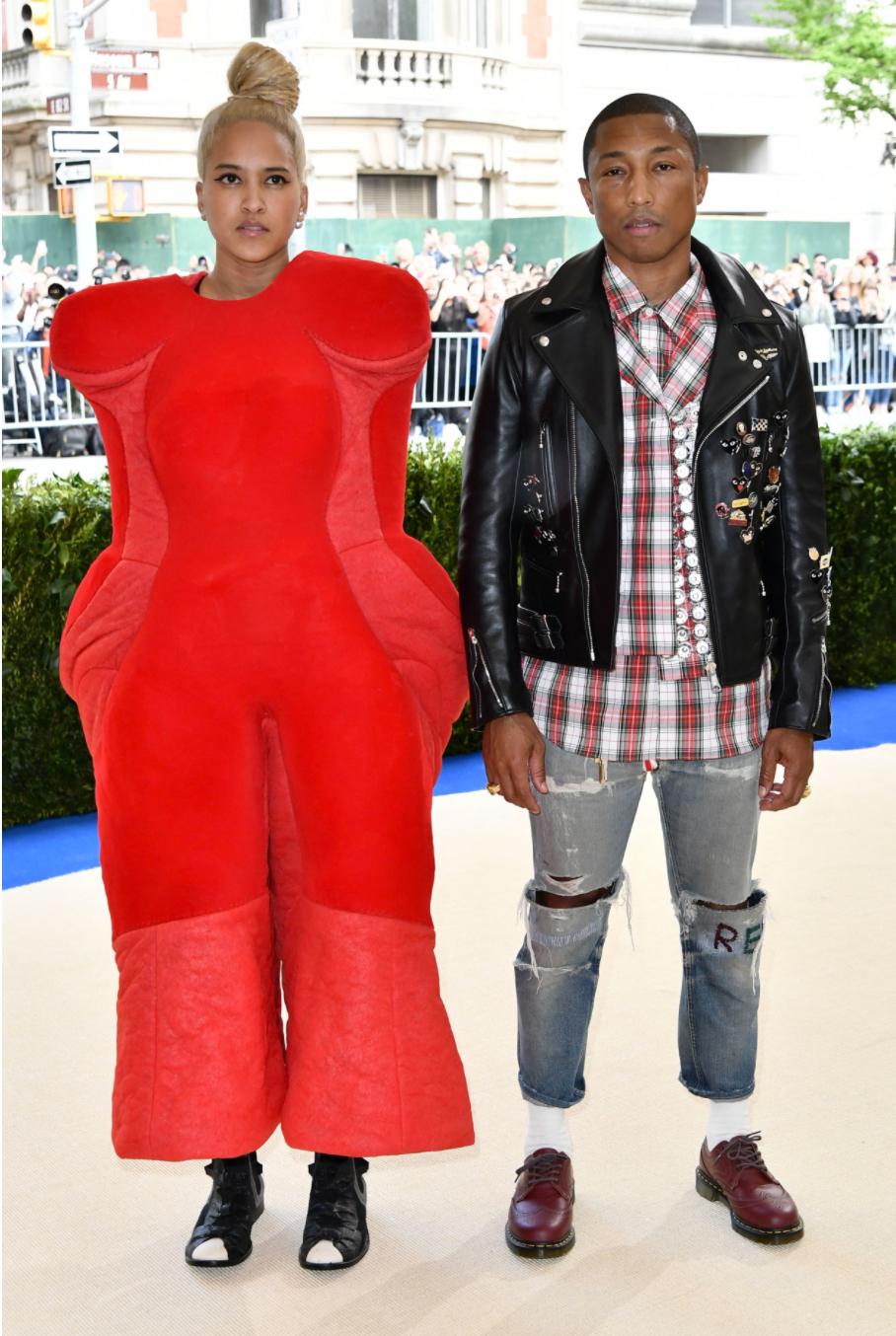 Helen Lasichanh (left) and Pharrell Williams (right) in Comme des Garçons.