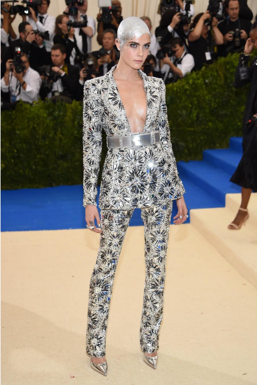 Cara Delevingne wears Chanel.