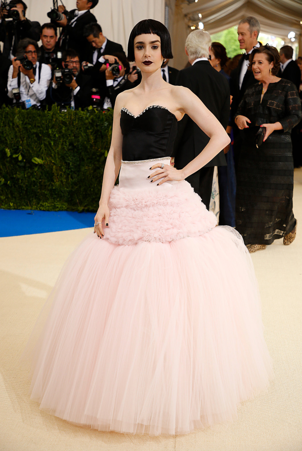 Lily Collins wears Giambattista Valli.