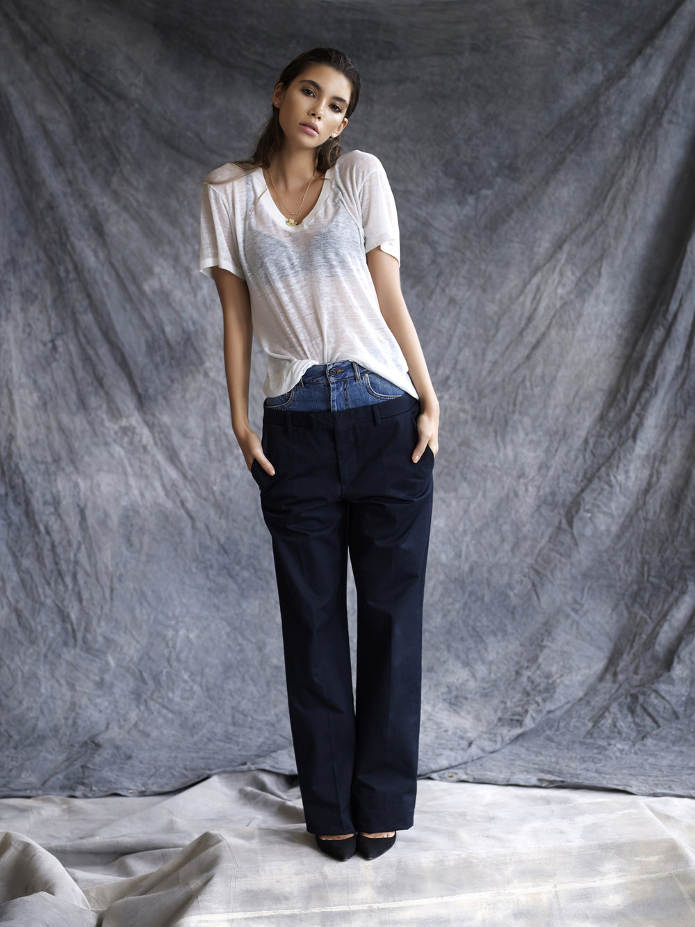 Cindy wears  a  WCAGA  vintage t-shirt,  Maison Margiela  pants,  Manolo Blahnik BB Pumps, Halleh  necklaces and earrings.