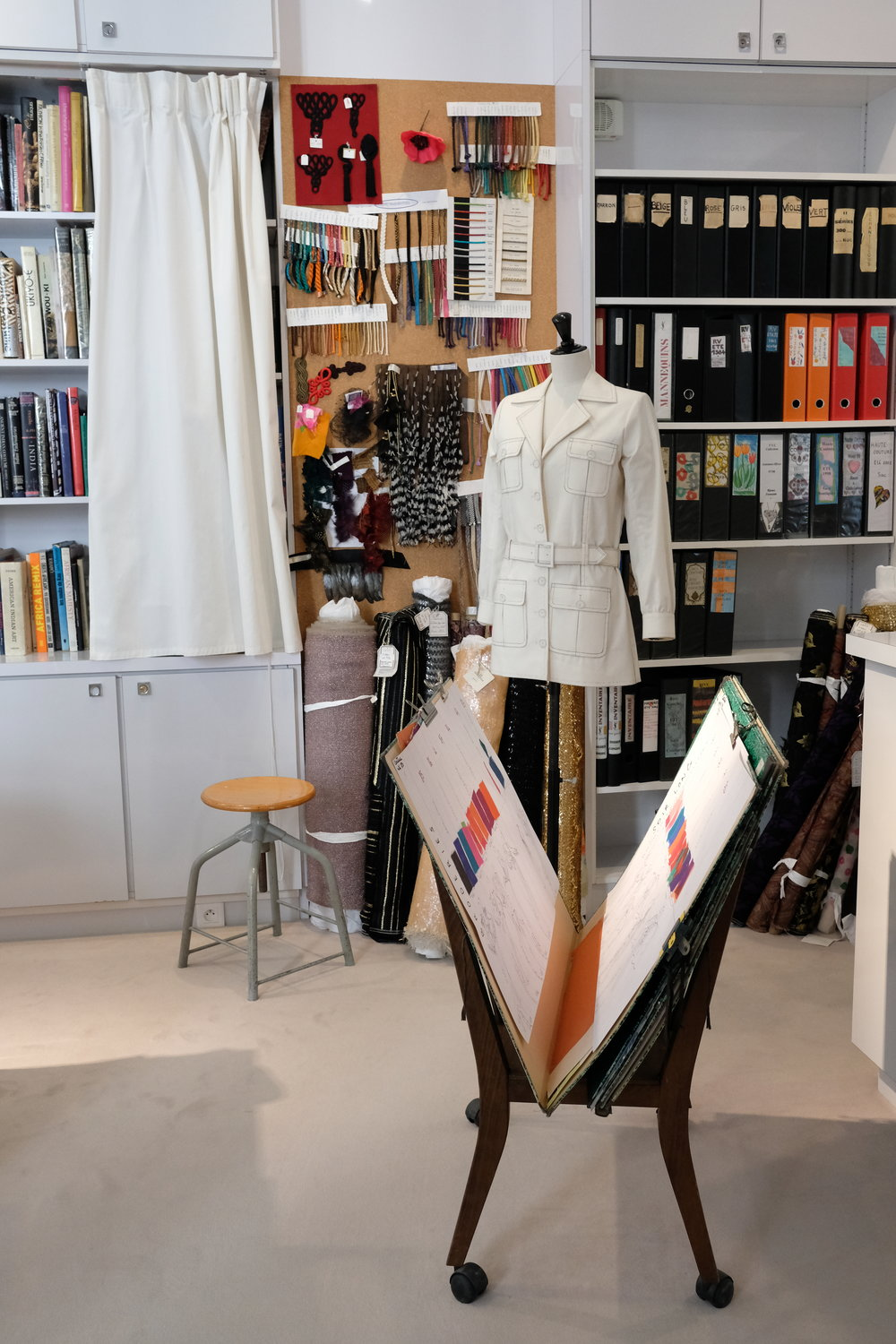 Inside Yves Saint Laurent's office and studio, a muslin draft of the famous safari jacket and swatches.
