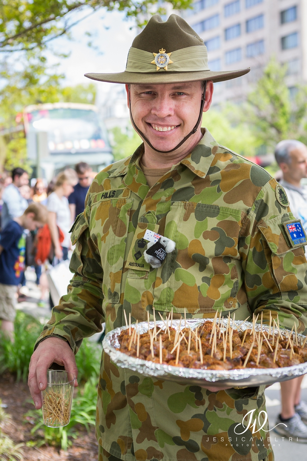 Aussie serving sausage samples to the long line outside the Australian Embassy