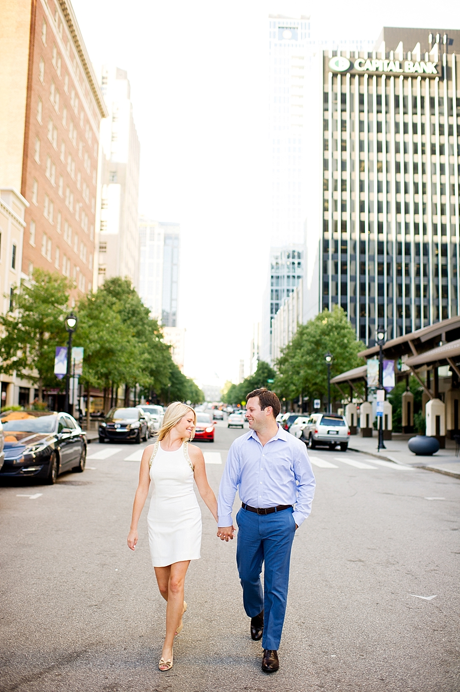 Ashley & Ty's outfits for their spring downtown Raleigh engagement session were perfect for the setting and time of year.