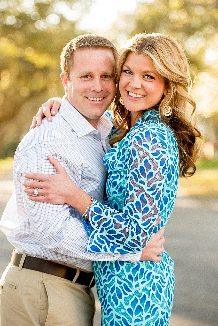 "Lauren's dress is a great example of breaking the ""no pattern"" rule. It was a quintessential southern coastal style, and her pretty gold dangling earrings and bracelet work well. Chris' shirt color, khaki slacks and brown belt were a perfect complement."