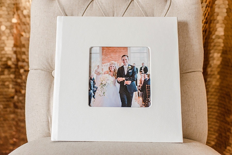 "12x12 30-sided custom wedding album wrapped in ""Polar"" leather featuring a square ""cameo"" image insert. This is the largest sized album we offer."