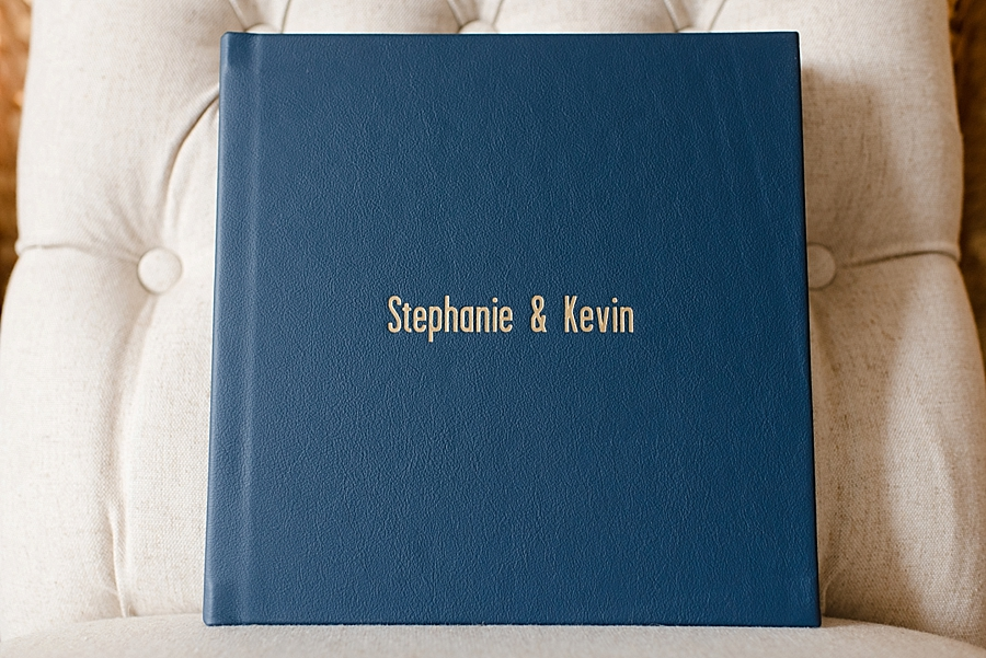 "10x10 30-sided custom wedding album wrapped in ""Monsoon"" (a great Navy blue) leather featuring debossed lettering. The couple's wedding colors were Navy and yellow, which made this combination perfect. The variety of leather and linen colors will allow you to select one complementing your own wedding colors, or you may opt for a classic black or white. The 10x10 30-sided is our most popular size for wedding couples."