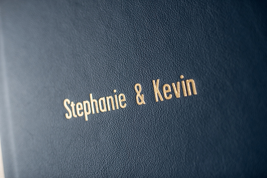 A close up of the debossed gold lettering and Navy leather combination. Foil colors are available in Black, Copper, Gold, Granite, Matte Gold, Matte Silver, Silver, and blind (no color).