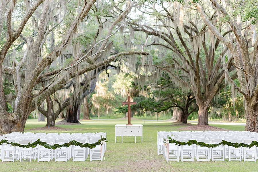 This ceremony site at Litchfield Plantation in Pawleys Island, SC was photographed at golden hour. The sun is low on the horizon and the this spot has been left in open shade, making the light even and beautiful.
