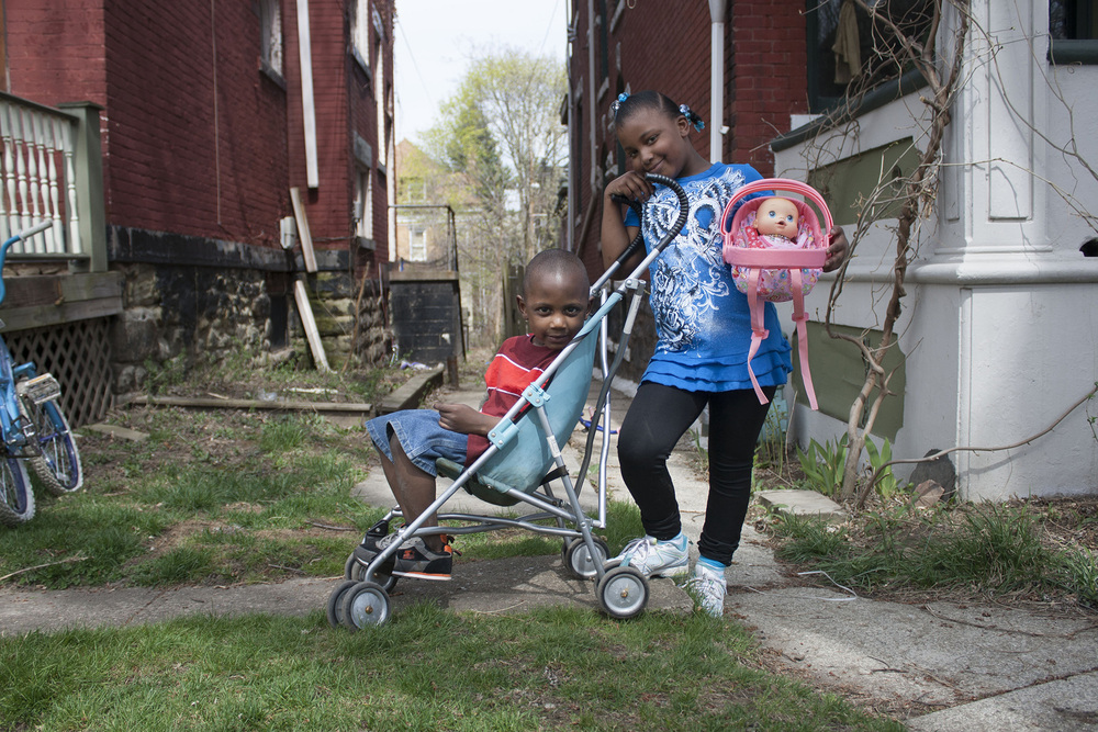 Raheim and his older sister, Raysha, playing in the front yard.