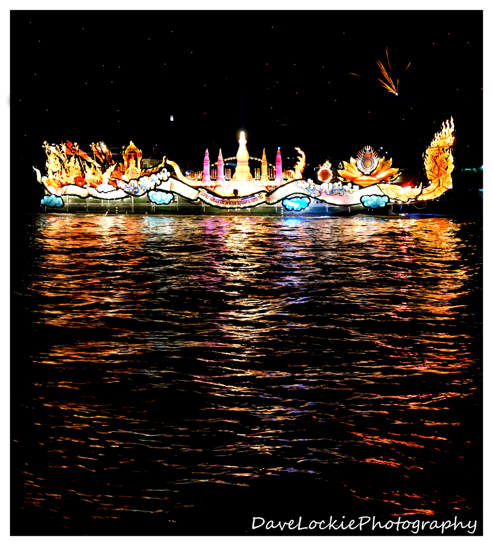 One of the colourfully illuminated boats on the river.