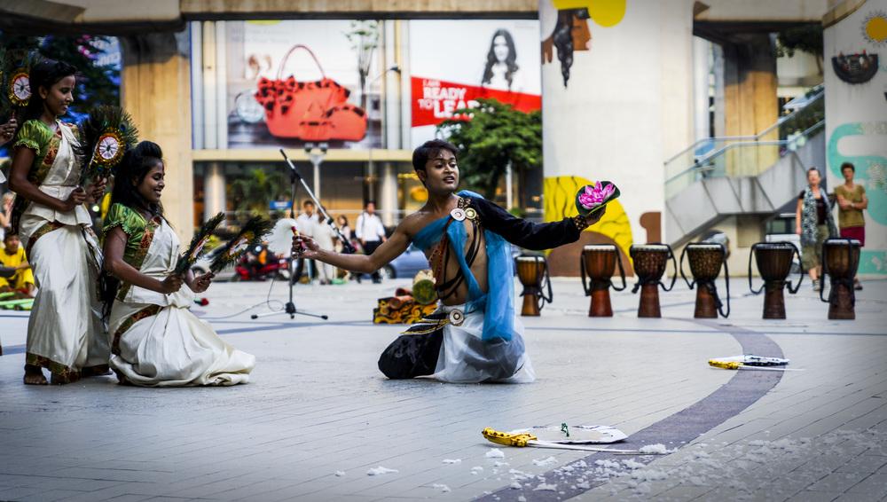 Komai Gandhar performing traditional dance, poetry and drama.