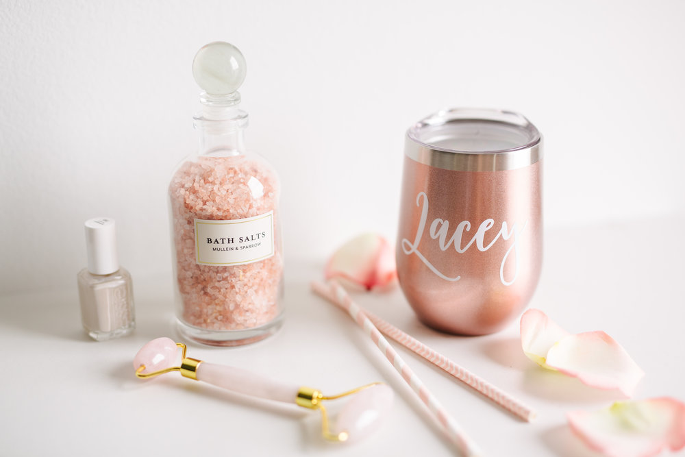Pamper yourself or your galentine! You just can't go wrong with a warm bath sprinkled with these rose himalayan bath salts from  Mullein and Sparrow , some Essie nail polish, this  rose quartz facial roller  that feels divine, and of course a glass of your favorite wine in this personalized stemless glass from  Bridesmaids Gifts Boutique  that stays cold up to 9 hours and hot up to 3 hours! This is also the PERFECT gift for asking your bridesmaids to be in your wedding or for a gift set to give to them on the day of, ladies!