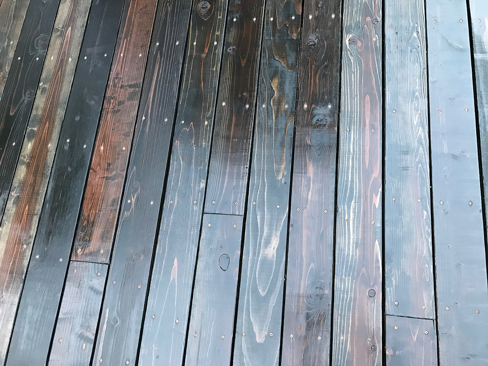 the redwood colors under the stain lend a nice warmth to the deck
