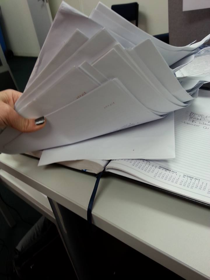 Piles of contracts being processed
