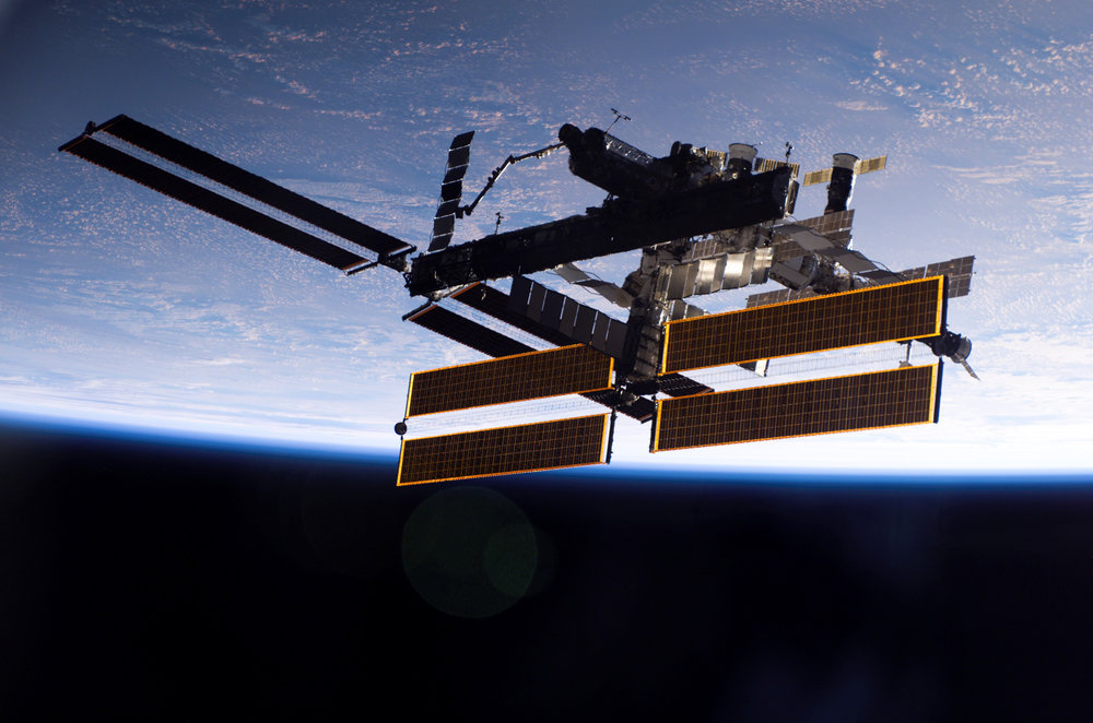 The International Space Station against the backdrop of Earth in 2006 (Courtesy of  NASA )