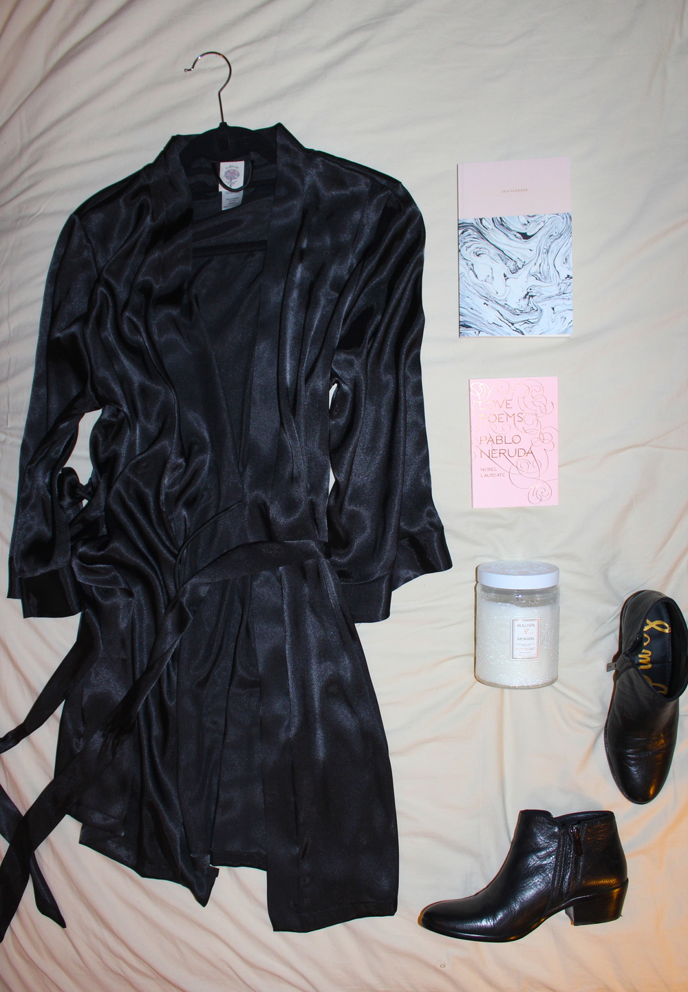 { robe / planner / book / candle / shoes }