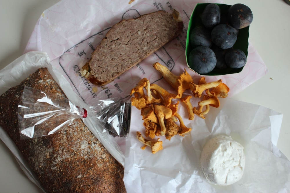Sunday morning market spoils {clockwise: pain des amis / pâté grand-mère (pork terrine) / figs / fresh goat cheese / girolle (chanterelle) mushrooms / chocolate truffles}