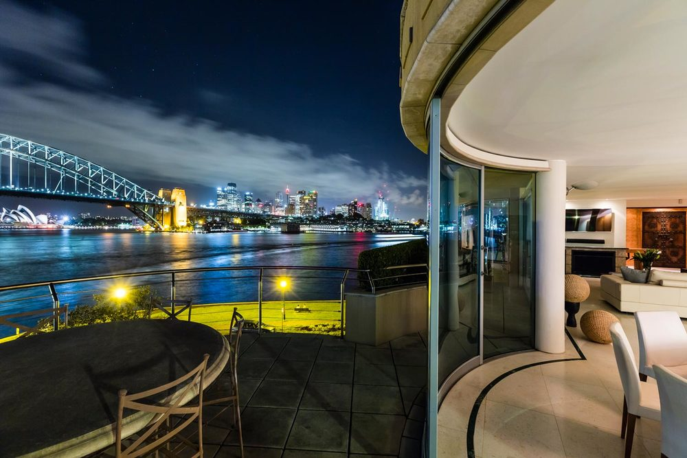 la corniche, designer apartment in sydney harbour for rental, australia, night time view