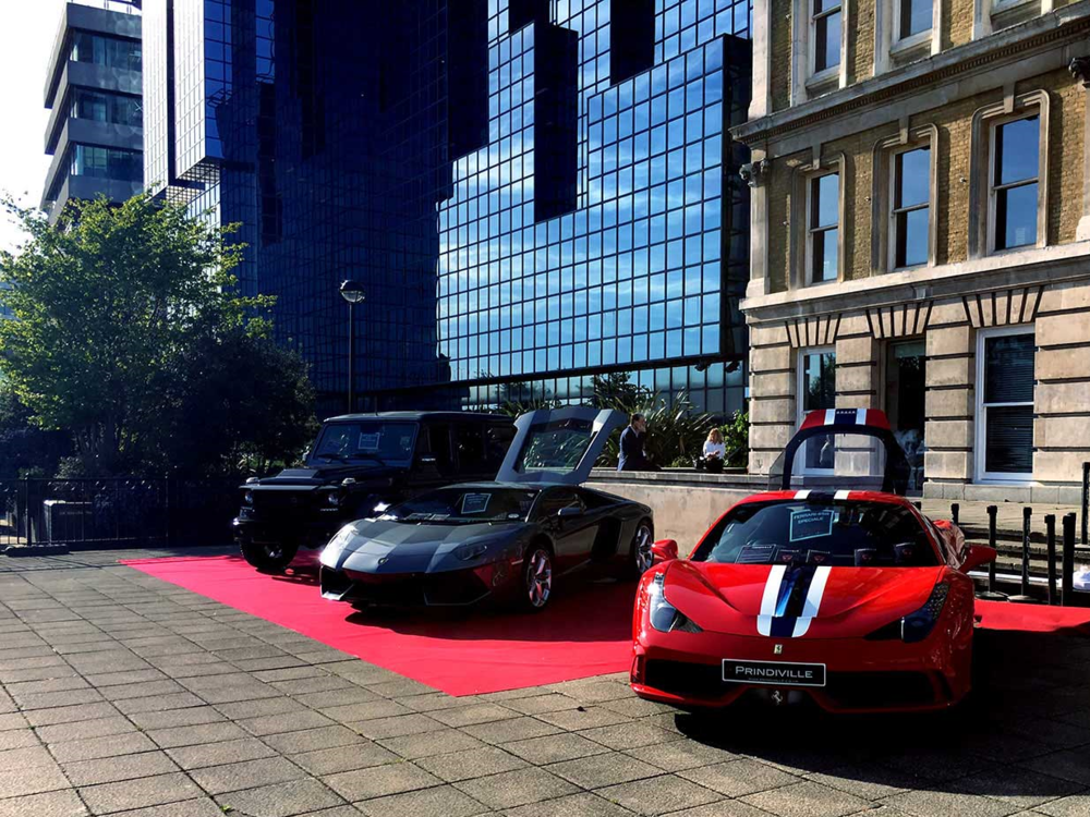 Prestige cars welcoming visitors to the London Yacht, Jet and Prestige Car Show