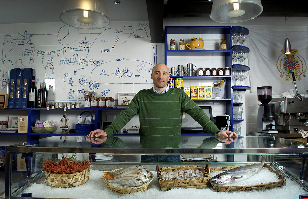 Environmental Portrait of a fishmonger in a fish restaurant in Nottinghill , London