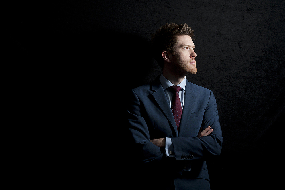 Portrait of a businessman in a suit in London with dramatic lighting