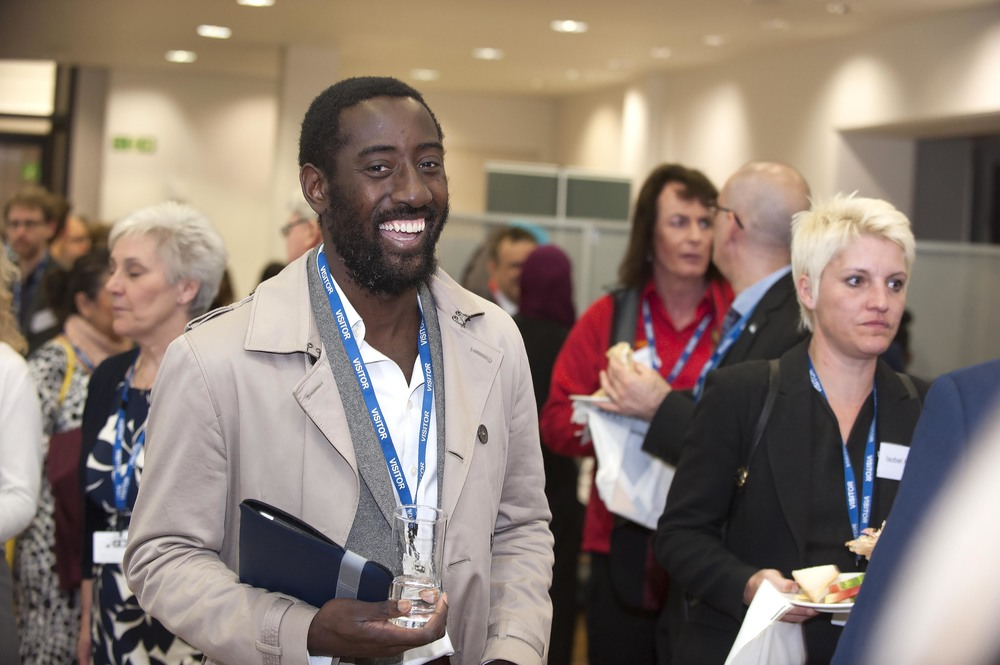 Attendee smiling to camera at a conference event