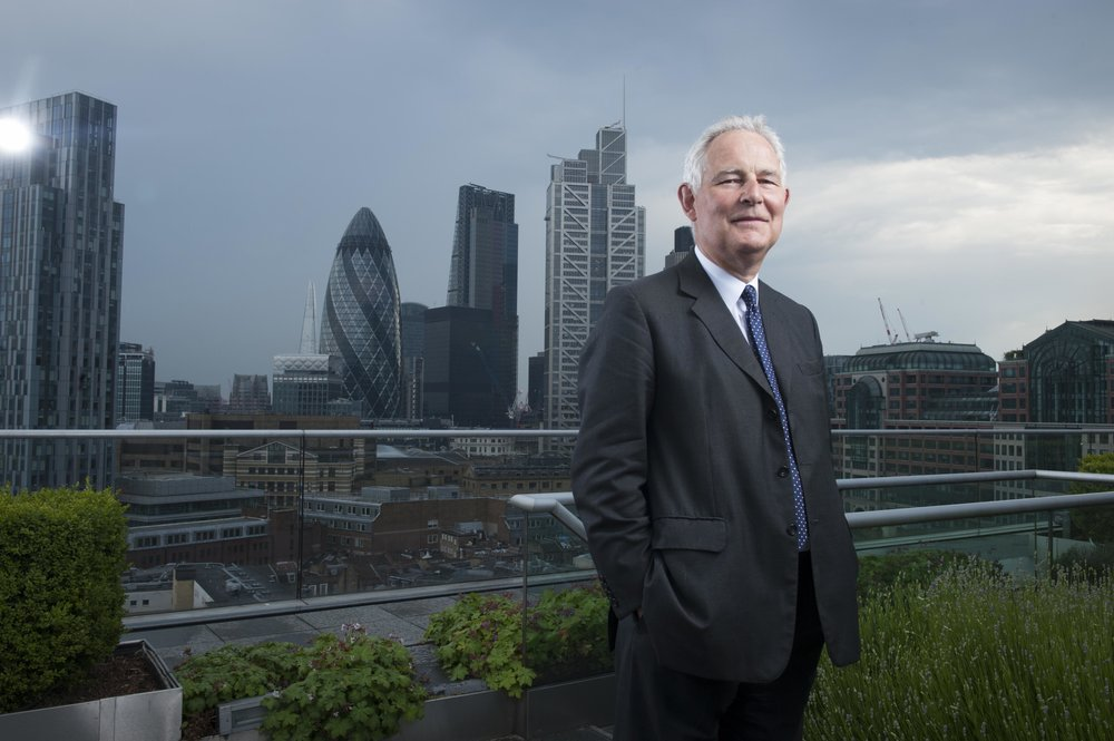 Corporate Portrait of a businessman in a suit with London Skyline & The Gherkin