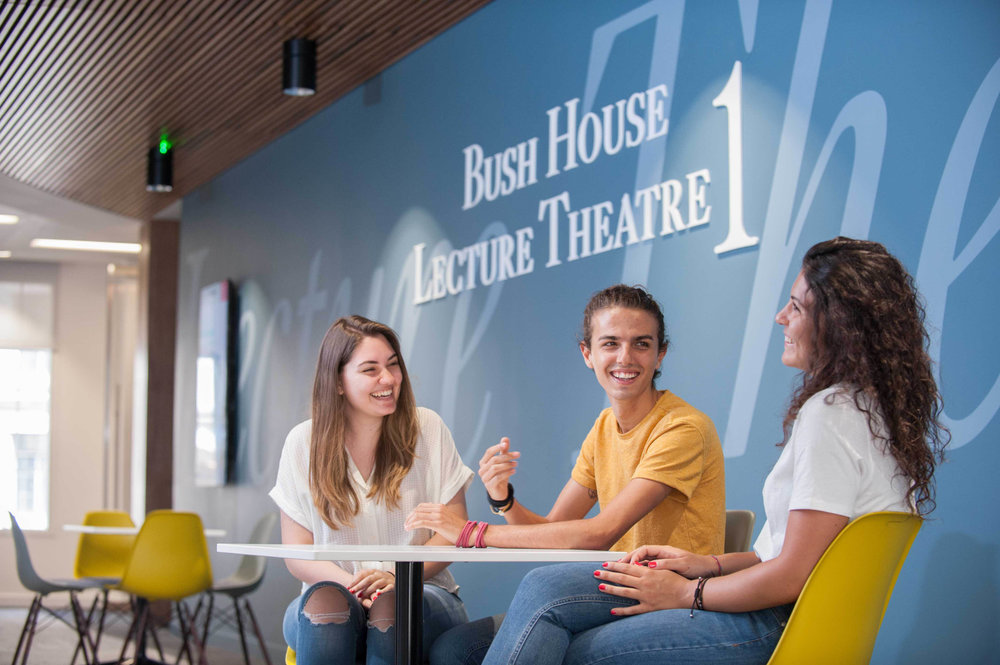 Portrait of Students laughing and talking at Kings College London