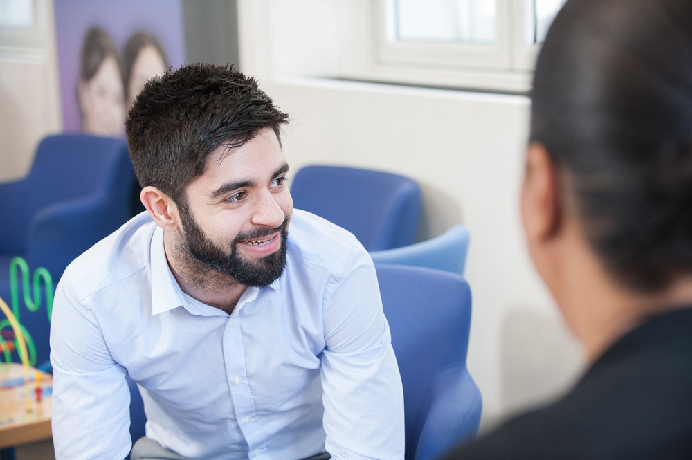Candid Portrait of a businessman with a beard laughing in an office