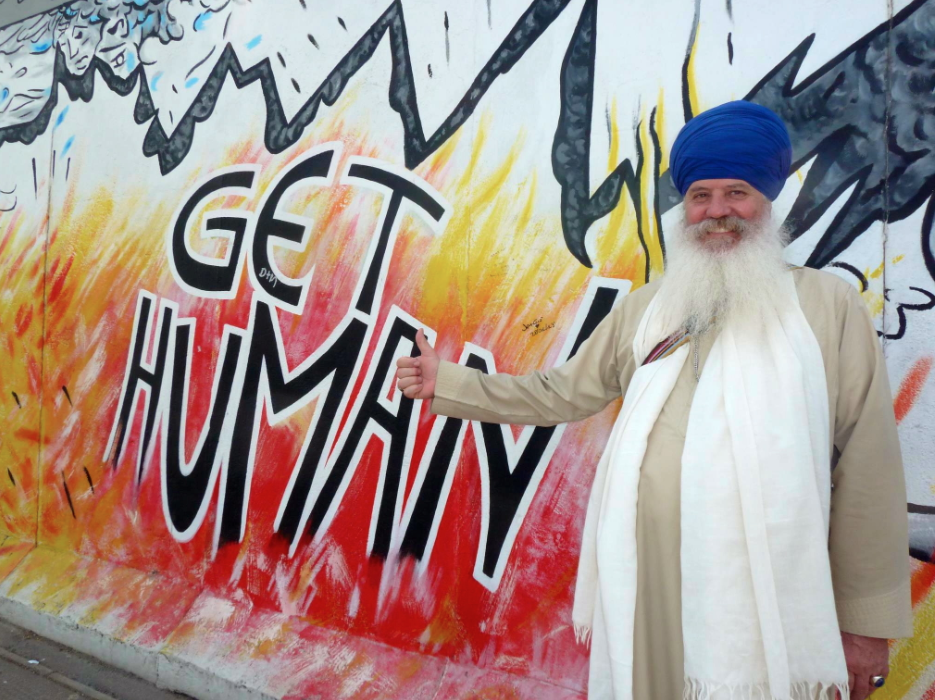 The incredible Karta Singh enjoying some surprisingly spiritual graffiti!