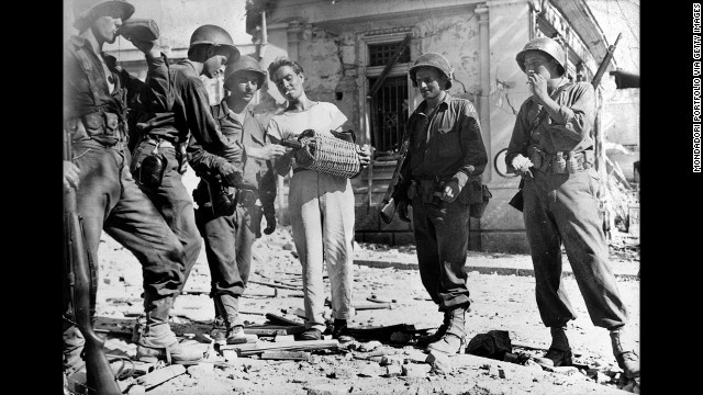 A Sicilian offering soldiers wine during WWII.
