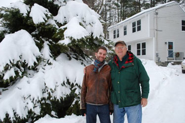With my father in front of my childhood home during a typically snowy Maine winter