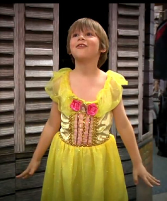 """""""The Belle dress is a bright shimmery yellow and in the soft light it looks like gold... It would be impossible to be sad in that dress."""""""