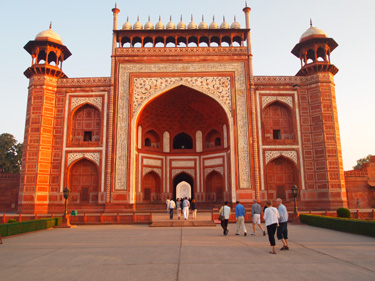 """The world transformed - in the burnished gold of the winter afternoon sun, the umber-red sandstone used for the whole complex at Fatehpur Sikri seemed like carved fire, something the sun had magicked out of the red soil in their combined image and likeness."""