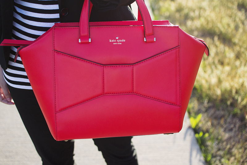 I fell victim to the Kate Spade sale recently and ordered this gorgeous bright Beau as a work bag for half of it's original price! I fell in love with this bag when it was first released (uh, hello, bows!) but my excitement waned slightly when I saw it on the arms of several large bloggers (c/o, of course). I constantly struggle with not wanting to be a follower (baaaah) but also really loving something even though everyone already has it (hello, rockstuds and pashli). Some things are just good, though, and this bag is one of those things. PS - it has a padded tech pocket for my iPad. Kind of a selling point for me. It's plenty large enough to tote my daily necessities to work and back and I got a great deal, so I don't regret this purchase at all.