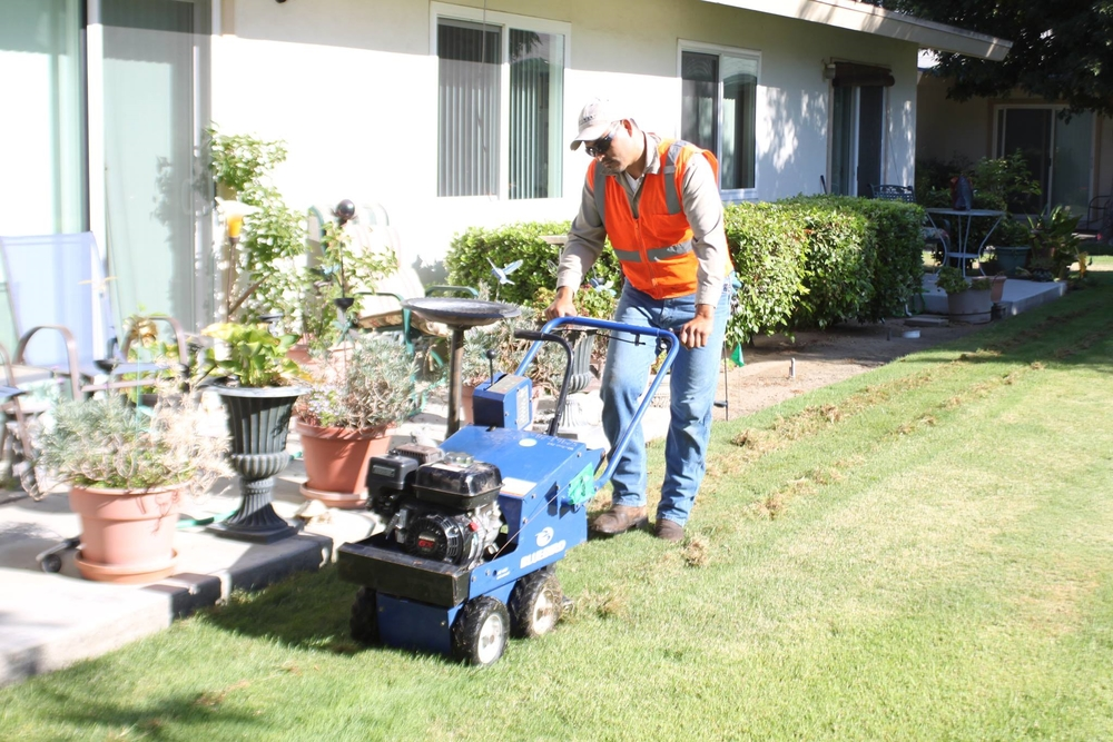 Vidal Huerta of Stewart Landscaping  removed 3,850 square feet of lawn on July 17 at our Garden Apartments. (Photo courtesy of Craig Macho/Ripon Record)
