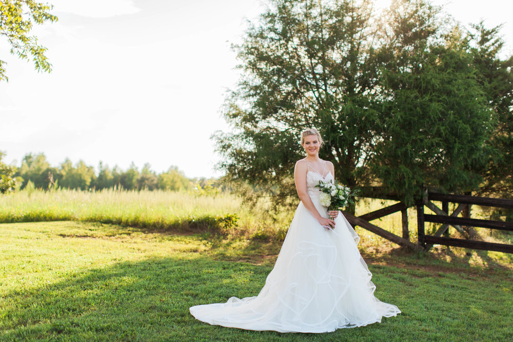Beautiful bride in wedding dress at Ellery Farms